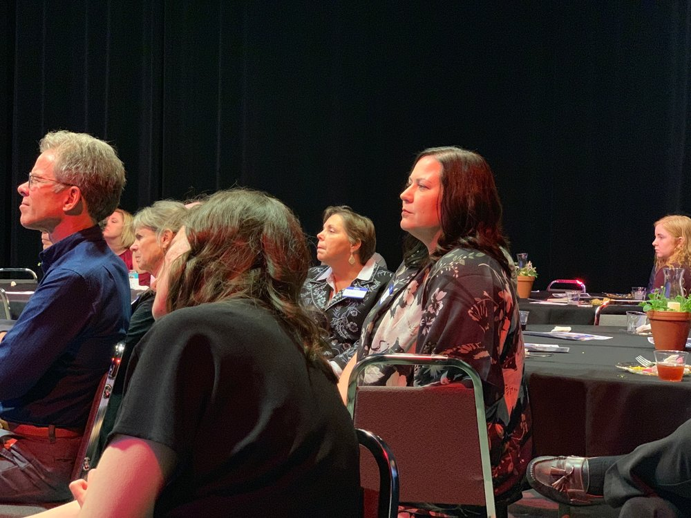 Guests listen intently to guest speaker Chase Cook