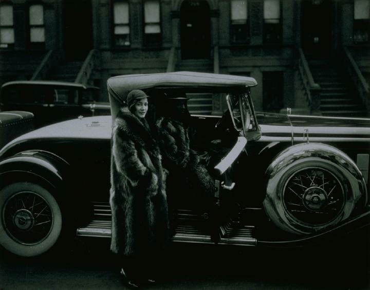 Couple in Racoon Coats (a couple wearing racoon coats with a Cadillac, taken on West 127th St.), 1932