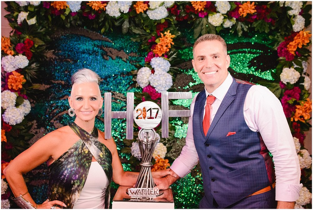 Pro Football Hall of Fame Induction 2017 - Brenda and Kurt Warner pose with an art piece welded for the special commemoration in 2017.The earrings worn by Brenda are also MetalArt by B pieces.