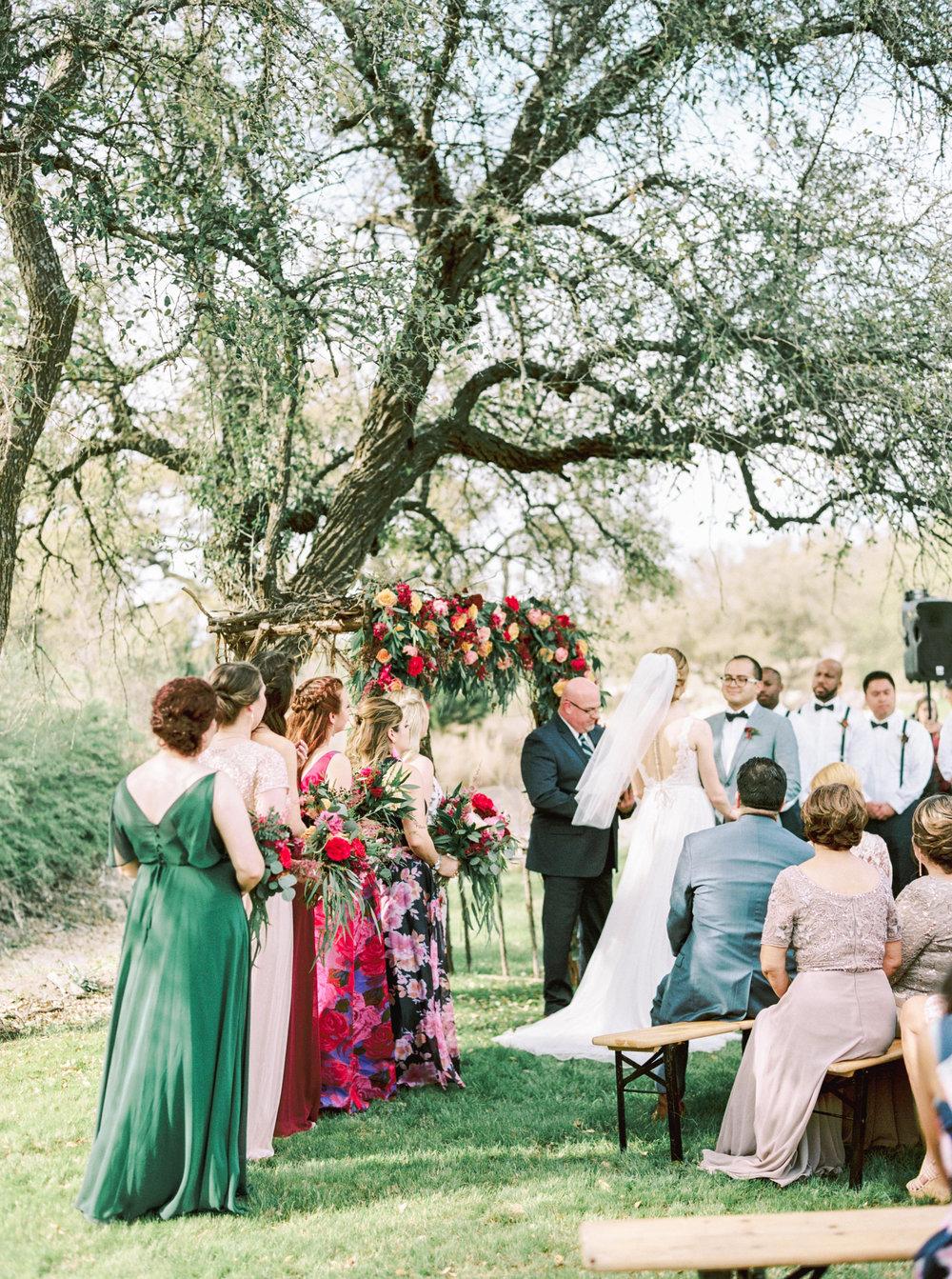the-creek-haus-wedding-venue-austin-texas-wedding-destination-venue-with-lodging-style-me-pretty-bridesmaids-mix-match-dresses