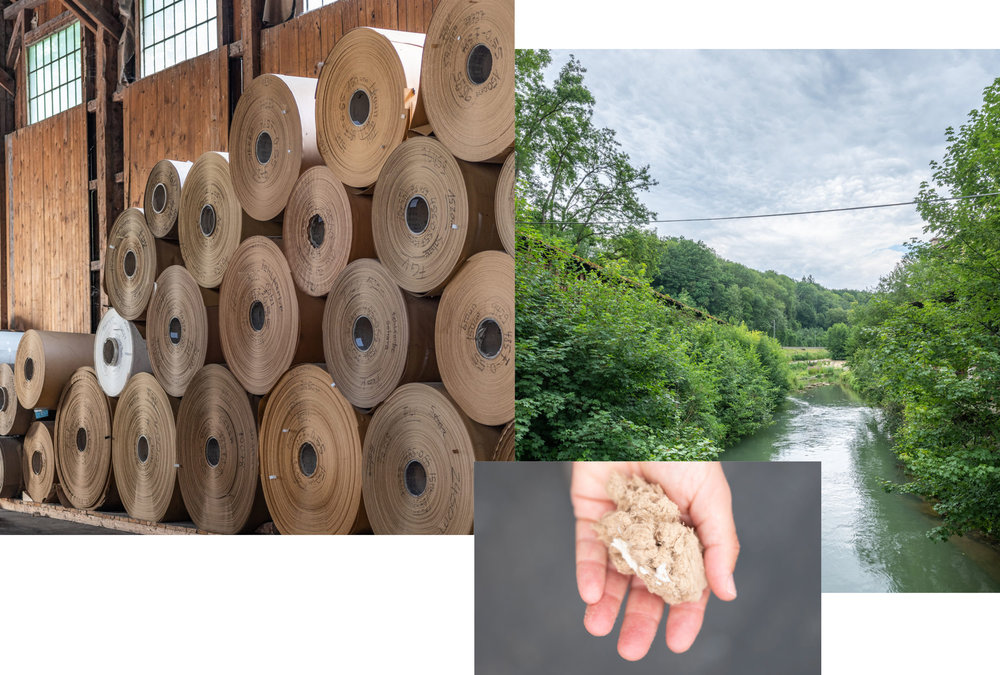3 photos from the Supernatural Paper factory in Germany. Rolls of paper, a beautiful river scene from near to the factory and a hand holding some paper fibres.