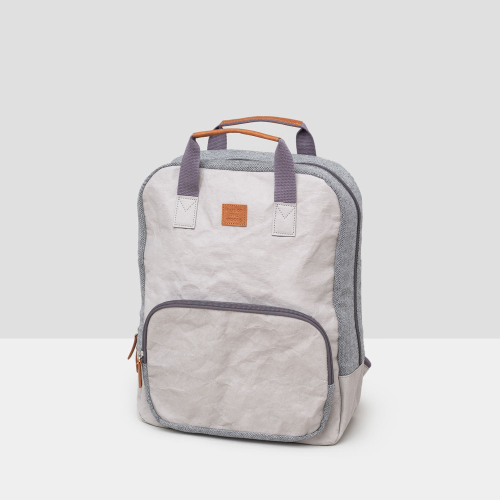 Backpack in light gray Supernatural Paper, with areas of herringbone for contrast