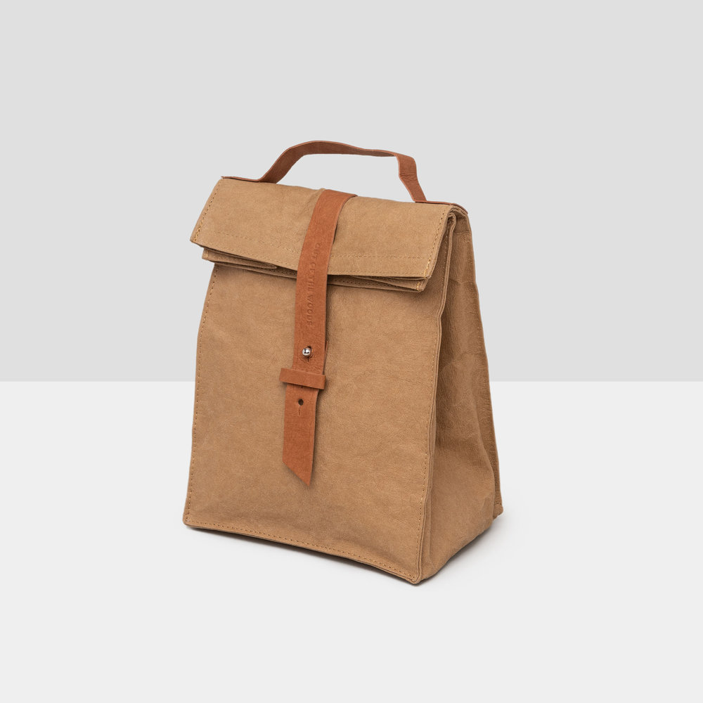 Woods Paper Sac in brown Supernatural Paper with thick brown closing buckle