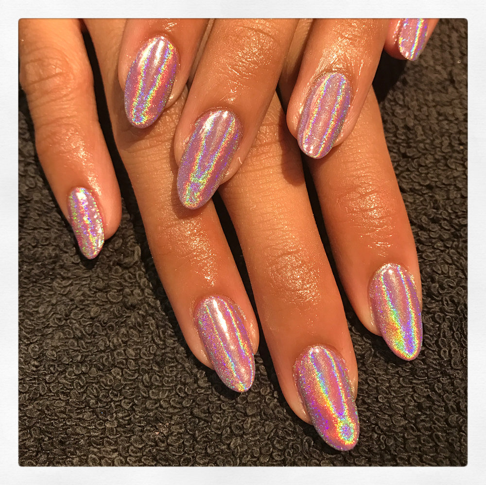 Chrome - A super shiny mirror finish available in gold, silver and holographic. It takes the process of a traditional shellac manicure one step further with a special powder that transforms into a smooth shiny surface.£10 extra on any treatmentSelect 'Chrome' add-on when completing your booking