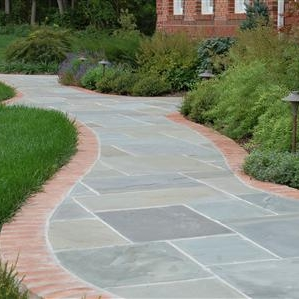 flagstone walkway.brick border.jpg