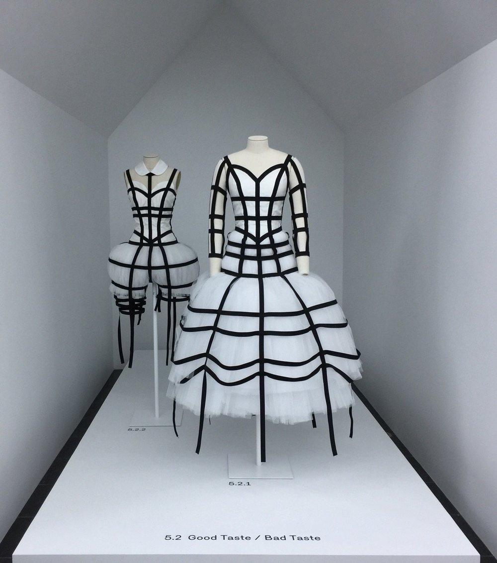 "CLXXIX. All in Good Taste -      *Pictured: One of Rei Kawakubo's installation at The MET's Costume Institute exhibition, Comme Des Garçons.    That moment: you glance at the upper right-hand corner of your iPhone and your eyebrows furrow. The battery life is dwindling down, and now you have to ration your use of it until a charger or an outlet becomes available. The battery isn't so low, but you know you will use it up in no time.    And then it dawned on me: I find that amount of battery life to be too low and yet the number is higher than how much I weigh on the scale.    Scary times we live in - I live in, isn't it?    I'm at odds for what to do. I'm seeing a fork in the road. I'm seeing twigs stemming from a single branch. I'm taking a double take. I need a second opinion. I am a Gemini.     My mind is flummoxed. I want to yell and scream at the world. Why did this happen to me? Why do people say that I did it to myself?  I want to eat more, but every time I'm about to, something happens. I get a terrible cramp in my side, I'm uncomfortably constipated, or my darling mother wills herself to workout and not eat breakfast or lunch just to spite me and to feel better about herself for the discipline it took- a character trait that landed me here in eating disorder land.    I want to will myself into not being phased by her antics, but I can't shake it off. I can't shake off that memory of me wearing the black A-line scoop neck shirt with the striped net panel as the back that she decided to wear today. I cannot ignore the flashback of having worn the drapery shirt on more than one occasion. I was complimented whenever I wore it. I can't shake off that memory of having gone to a local ethnic market in Philadelphia during college, bending ever so slightly to pull out money from my wallet and then catching the cashier attempt to score a glimpse of my delicate décolletage - It was ever since that moment that I had decided to give the coveted shirt to my mother.    Moments like those, when I attracted unwanted male attention, made me feel unsavory and vulgar, in no part due to anything I had done, but it didn't feel that way.    What I would do to endure catcalls again than have to remain circling endlessly around my house, trying to stave off fullness and get in some movement. What I would do to not feel forced to wake up before dawn daily, just so I can squeeze in some time to move before I am monitored.     I used to think that the car was my refuge. It was my rocking chair that lulled me into a peaceful slumber. The truth is, my body is exhausted and sitting in a moving car forces me to stay still and gives me some much-needed respite. It was the same during college, when I was sleep-deprived for more valid reasons. Or rather, more socially acceptable reasons - to study, to dance, to earn a degree - body and mind, correct?    During those times I would fall asleep anywhere - on the couch in the living room when I came home and of course, whenever I was in the car. My parents would find it sweet to see their baby girl drift off into her dream world.     This is no longer the case. They reprimand my tendency to fall asleep in the car. I'm boring now, they say. I need to sleep ""normally,"" at home and in bed for at least 8 hours. Everything I do is considered abnormal now.  I was always considered a hipster before the popularization of the word, or as my father says, ""not part of the mainstream."" He seems to think that he should have put a stop to my uniqueness in how I approached everything from putting a vent underneath my laptop to prevent it from overheating, to scowling at men with wandering eyes and setting up rules like not stopping my run on the treadmill until the person next to me had finished first.    In some ways he had a point: I always created rules for myself, like some sort of disciplinary boot camp as way to achieve self-actualization, perfection, that would just make things more difficult for myself and less ""happy."" As a child, I would give myself conditions, loops that I had to jump through, in order to get at something I wanted: Don't step on any cracks when walking down the sidewalk, for example. It wasn't a game. It was an obstacle course.  You can imagine the frustration at skipping a beat and stepping on the lines during chalked up hopscotch.    I had to be as close to perfection as possible. I never would swear, as in curse. I was considered a ""goody two shoes,"" back in grade and middle school. Turns out my peers who I still keep in touch with really respected that trait.    Now I throw shit to the wind and swear ""like a sailor."" Here's to actually throwing shit to the wind - to eating more and reclaiming a metabolism, an appetite, and life."