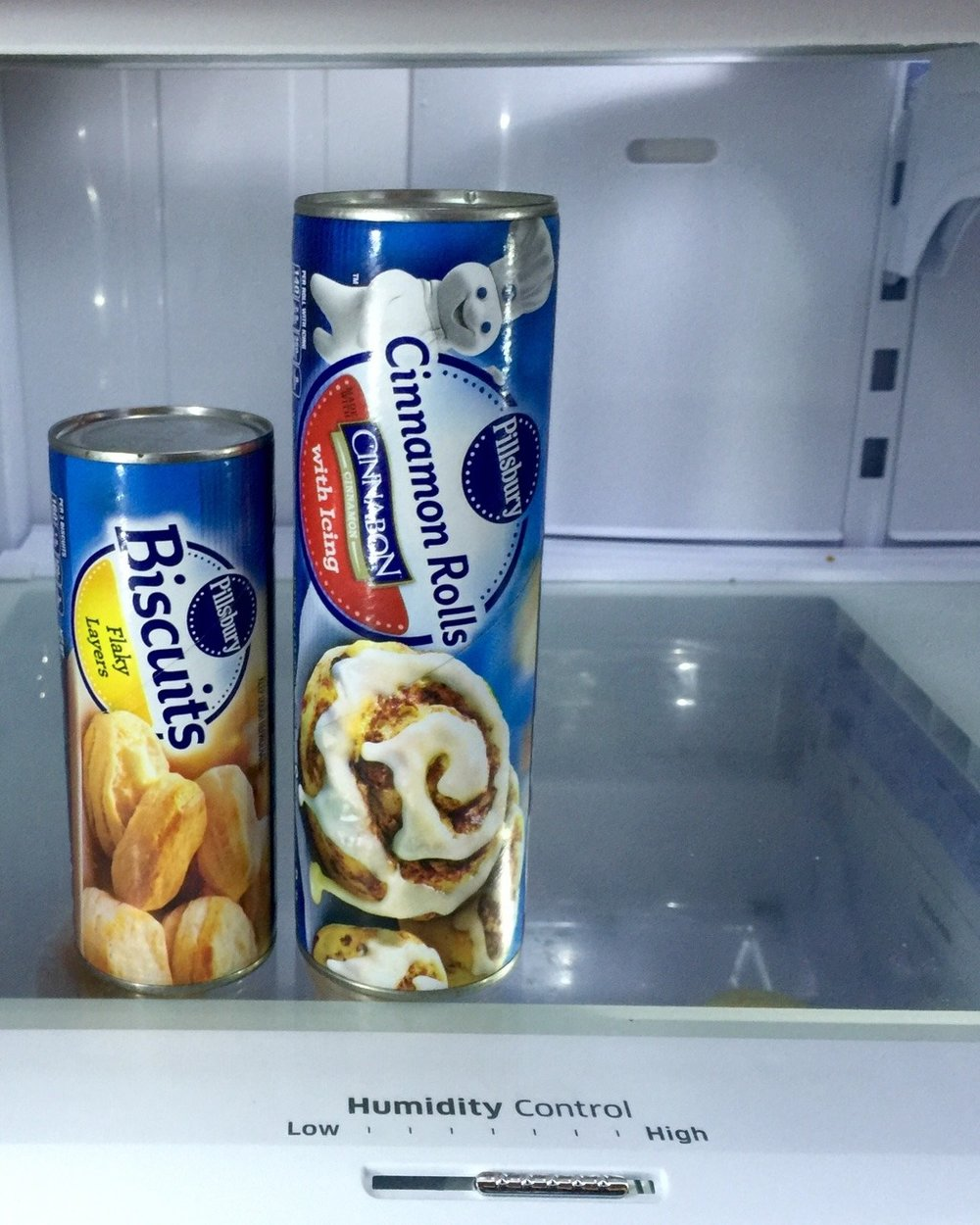 CLXVI. Pillsbury Dough Boy, Personified -    I took days off, weeks in fact. It was a break - a much needed one. I was straddling the mislabel of physical therapy with a workout. It sure as hell worked me out. I saw cuts and I felt aches - decreasingly so as time went on. The concept of rest days was no longer a foreign concept, nor were the twin identities of protein and power, and carb and cardio.    I was determined and developed a routine that inadvertently altered another in-place routine. The after-effects were like tremors before a full-fledged earthquake. My ears were sticking out again. My set of meticulously cared for white teeth, no plaque in sight, began to protrude once more.    How can the body be so fickle and yet so robust?     So I went in the other direction - Immobility and upped the food intake. The concept of gains reared its head, but not in the way of Kardashian-inspired baggage: the hard shell exterior. This baggage was the far more functional one - the canvas one that has an extra zipper with the option to expand your luggage, increasing the space it takes up by a couple of inches, enabling it to weigh more.    Sometimes I'm happy to be the Pillsbury dough woman.    If all it takes is a poke to make me giggle, to make me laugh like I used to, then white chef's hat I shall don- no questions asked.    Other times, I don't want to wear the all white suit with a pouch that sticks out and that rolls with every waddle-like movement. Then again, I've been accustomed to a waddle. It's some new sort of gait that is so unlike me but is required because of the gap between my thighs.    I don't want to start from square-one: to mold and carve new layers of protrusion into something more straight-edged and 2-D. Also, is it a coincidence that the color white is worn when honoring the dead with last rights?    Then again, I just purchased white attire for a summer wedding because of its light and airy vibe.    So here I am- going back and forth about what I want.There is pent up energy that has to be unleashed. And that's what I want.    I want to be that Pillsbury cinnamon roll or biscuit cylinder. I want to be unwound and stretched out, my internal layer to be revealed.   I want for all of it to take, like a poke of a finger to make me laugh, a fingernail to slit the interior cardboard cylinder, releasing the pressure and exposing the glistening dough inside.    The pros far outweigh the cons in this instance. Pillsbury it is. And when all is said and done, mark my words, I'll be dressed in a cute white chef's hat,  a button down white shirt tucked into white pants with an equestrian-style thin blue ribbon wound around a neck  (without the Adam's apple) for Halloween this year.   I haven't dressed up in a costume in far too long.   I haven't laughed in just as long.
