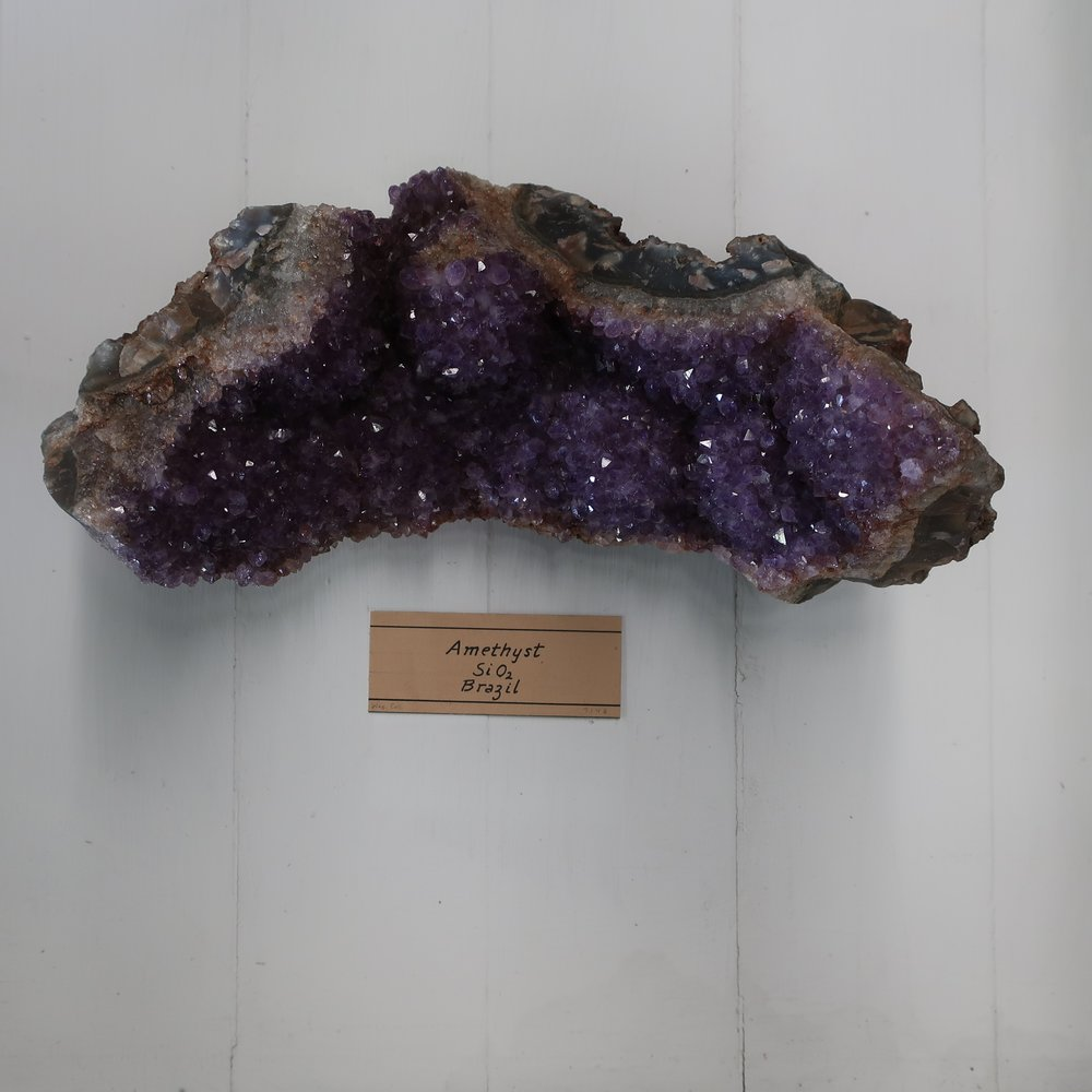 """""""Amethyst  yields 97.50% Silica with a trace of oxide of Iron, Alumina & manganeese. Amethyst chiefly differs from Common Quartz in its colour, which is purplish violet, supposed to be derived from a minute proportion of Iron and Manganeese which it contains. It becomes white by a long exposure to heat.""""   [READ THE FULL QUARTZ ENTRY]"""