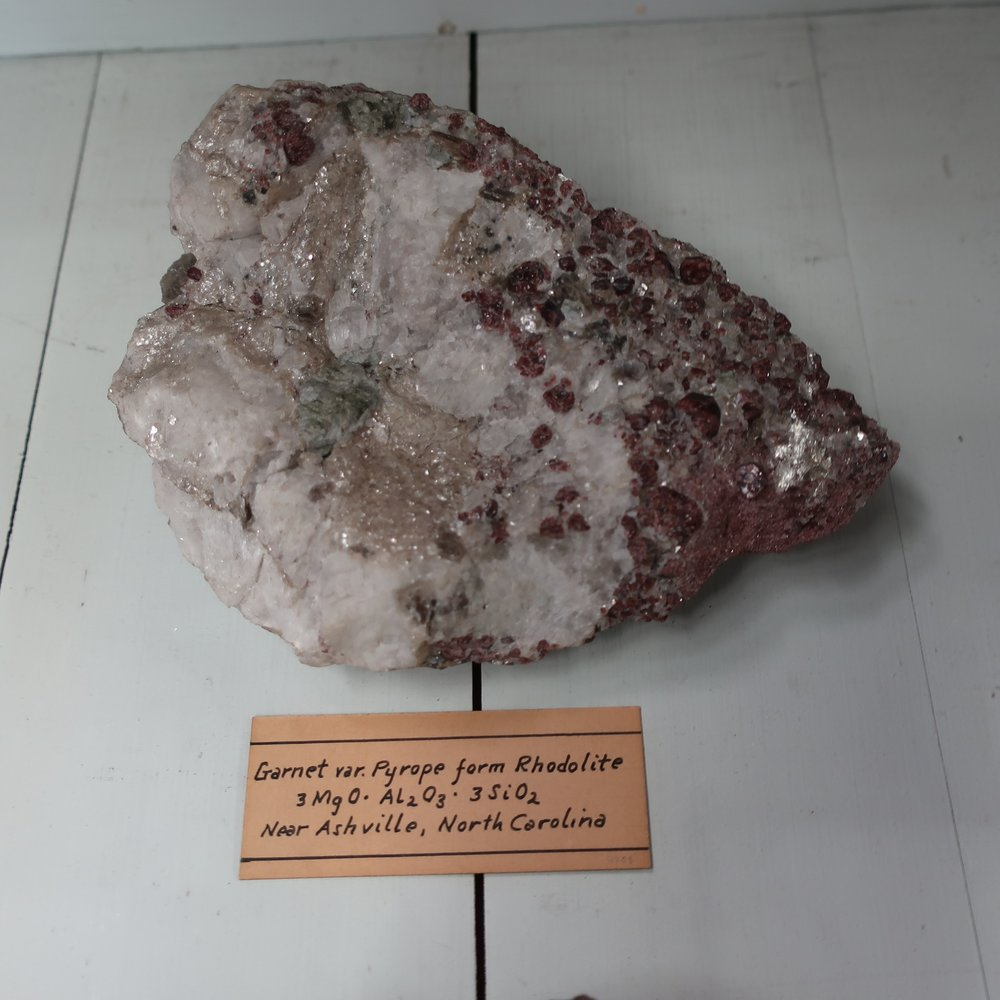 """""""Pyrope  differs from other varieties [of Garnet], in containing 7.68 &ct of chromic acid. And by part of its Iron, replaced, by Magnesia. It is found only in rounded, or angular grains, of red colour, it is transparent, and scratches glass. It is found imbeded in serpentine in Saxony & in Bohemia. This variety is rare in the United States."""""""