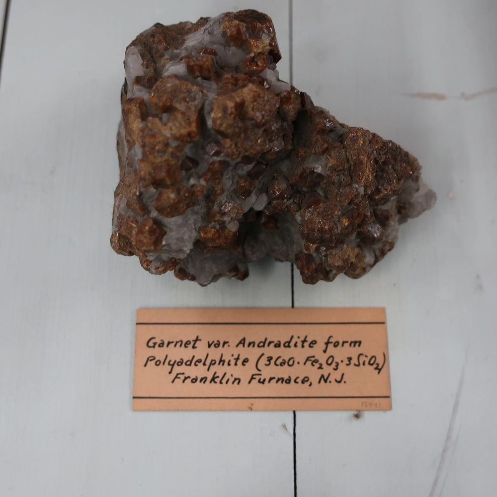 """""""Polyadelphite  is composed of Silica 36, Lime 24, Iron 23, manganeese 4, Alumina 3., Sp. Gr. 3.76. It is of different shades of yellow. The colors are not bright, some specemens bear a close resemblance to Blende. The mineral is composed of translucent roundish grains, and of imperfectly foliated masses; agglutinated together. The lustre is resinous; it occurs with Franklinite, and red oxide of Zinc at the Sterling mine Sussex County N.J. It is a rare mineral, and never found in crystals."""""""