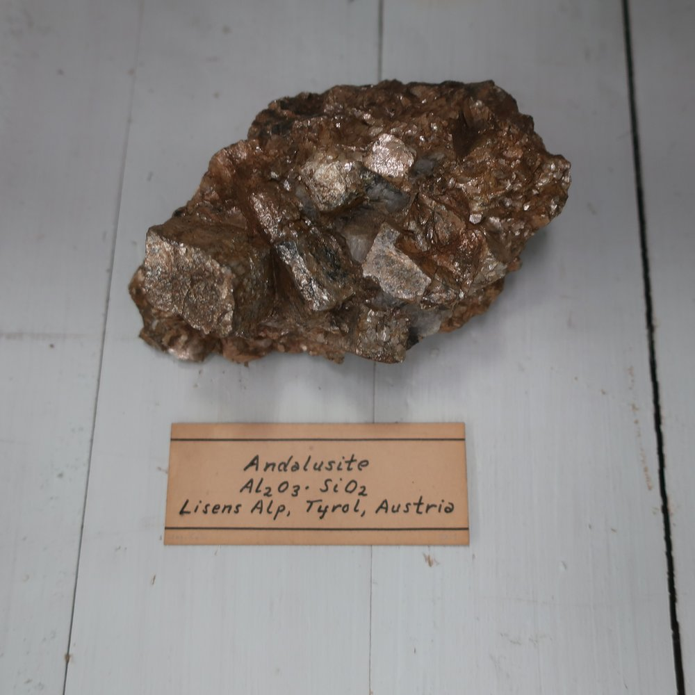 Andalusite  is essentially composed of Silica and Alumina, but contains several other accidental ingredients. Sp. Gr. 3.16. This mineral occurs massive, and in the primary form, a right rhombic prism. It has a lamellar structure with joints paralell to the sides of this prism, its colour is grey, of a redish tinge lustre is vitrious, fracture uneven and tough. Alone it is infusible, before the blow pipe; it is not effected by acids. Above Inspruck in Tyrol, where it occurs in very large crystals, this species is accompanied by another, which presents the same form, also in other places in Europe, in our country in several places, in Maine, Connect, and Masschts., also near Chester Pennsylvania in rough light yellowish crystals.