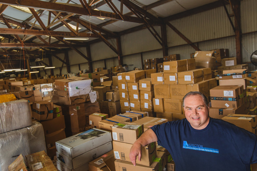 Jim Smith stands in the warehouse of his business, FBA Inspections, in Fort Bragg, CA.