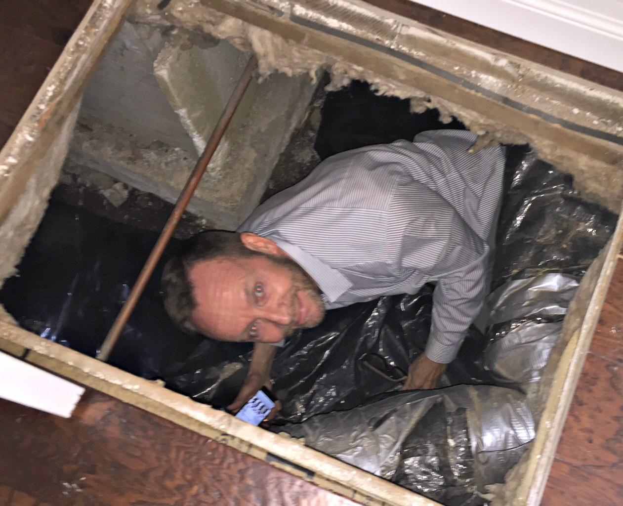 Roger inspecting crawl space