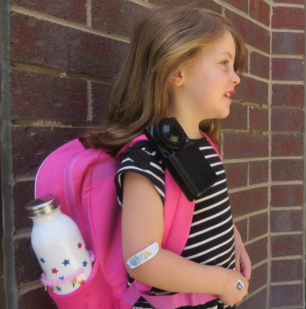 AST Child wearing the Ultrasonic Personal Air Sampler to detect her cause of asthma by tracking consumption of PM2.5
