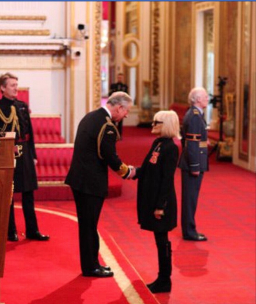 Barbara Hulanicki receiving her OBE award from Prince Charles
