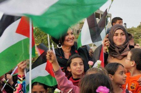 Children Cheering for the upcoming demining efforts in their village