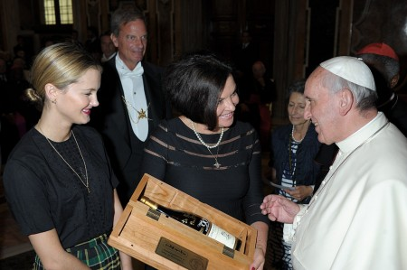 Heidi Kuhn, CEO, Roots of Peace, & daughter Kyleigh Kuhn MINES TO VINES bottle to His Holiness Pope Francis - October 2013-The Vatican.