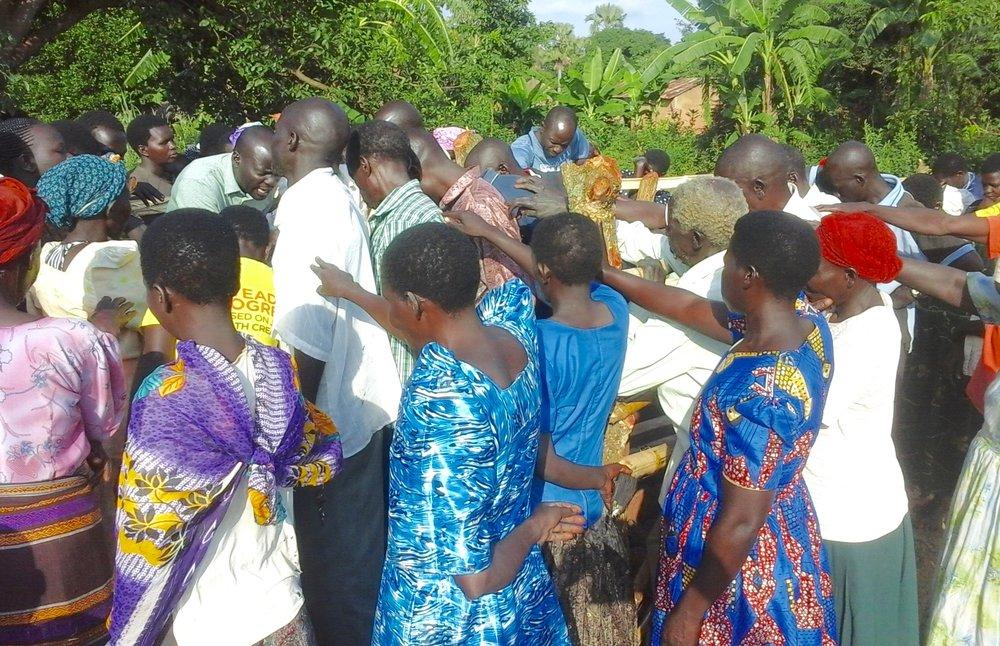 Praying over the borehole (1).jpg