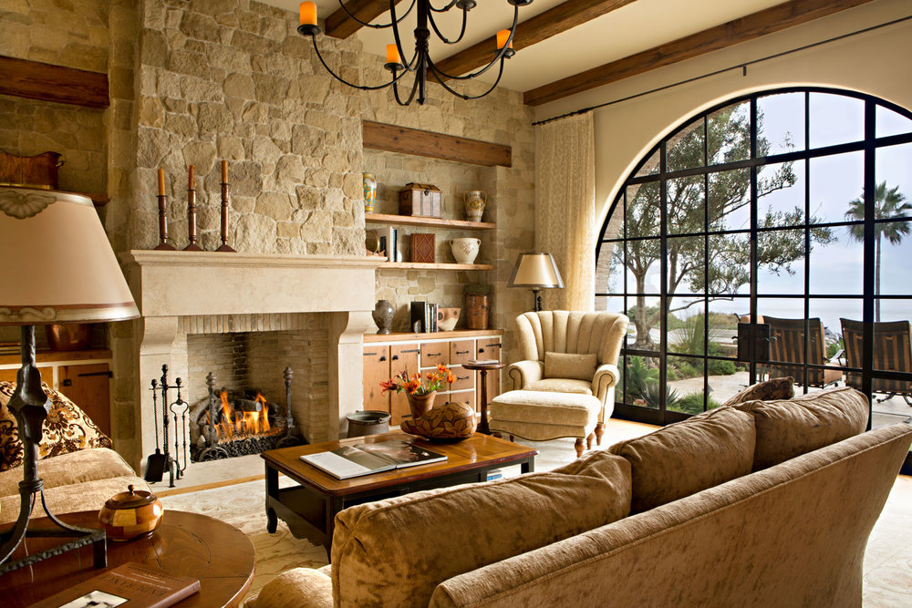 Mediterranean-Living-Room-Fireplace-Stone-Exposed-Beam-corbin-reeves.jpg