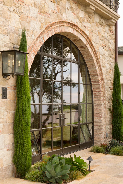 Tuscan-Mediterranean-Arched-French-Doors-Stone-Brick-corbin-reeves.jpg