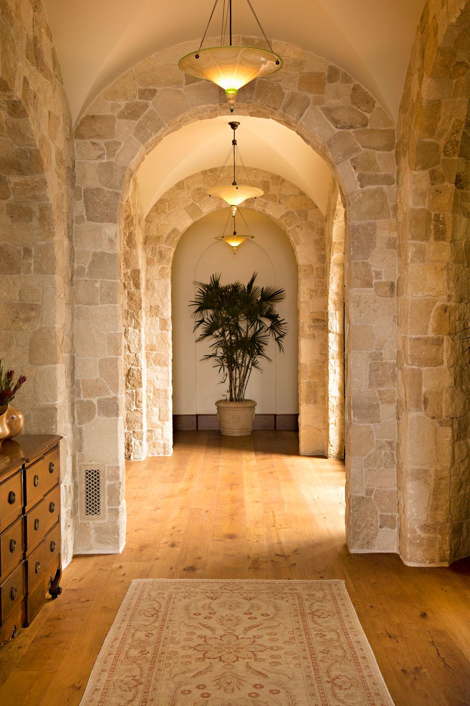 Tuscan-Mediterranean-Stone-Arch-Hallway-corbin-reeves.jpg