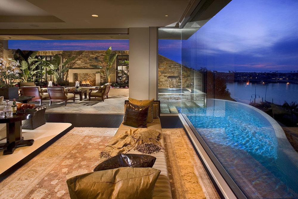Indoor-Outdoor-Living-Contemporary-Mediterranean-Infinity-Pool-Outdoor-Fireplace-Corbin-Reeves.jpg
