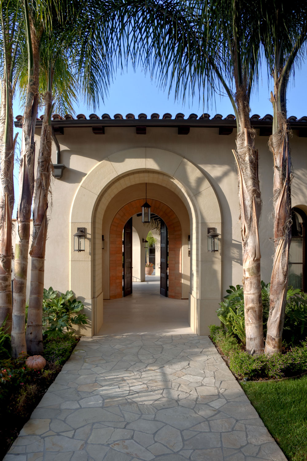Contemporary-Spanish-Flagstone-Walkway-Arched-Doorway-Courtyard-Corbin-Reeves.jpg