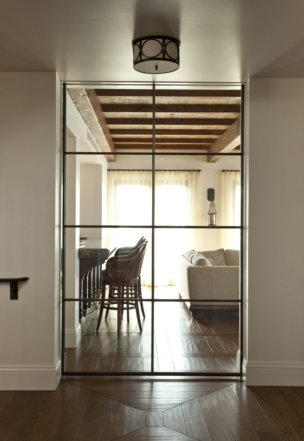 Contemporary-Spanish-Glass-Door-Wood-Floor-Detail-Corbin-Reeves.jpg