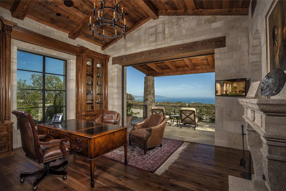 Mediterranean-Office-Vaulted-Beamed-Ceiling-Retractable-Doors-Corbin-Reeves.jpg