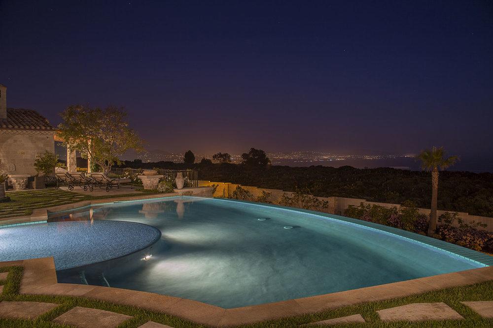 Rear-Yard-Pool-Views-Night-Mediterranean-Corbin-Reeves.jpg