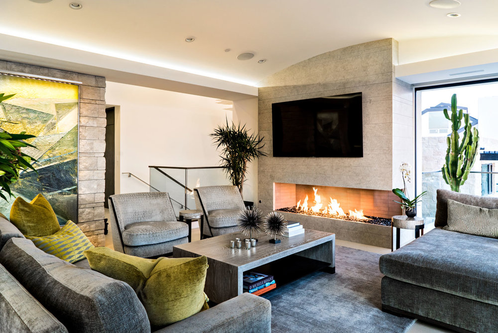 Contemporary-Living-Room-Fireplace-Stone-Wall-Corbin-Reeves.jpg