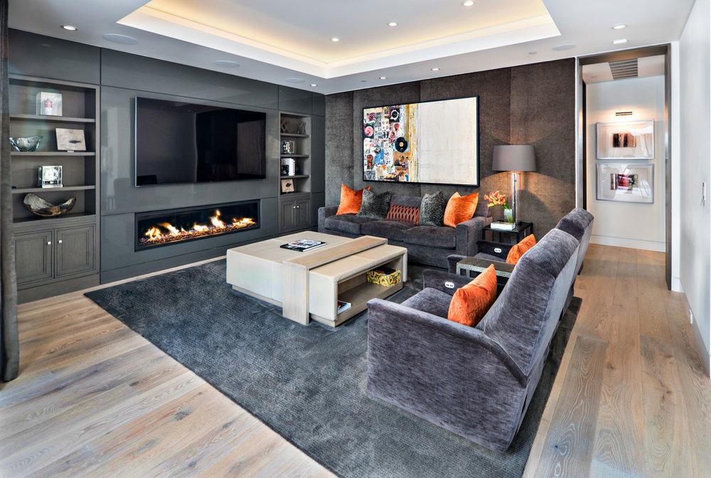 Modern-Screening-Room-Built-In-Cabinets-Fireplace--Corbin-Reeves.jpg