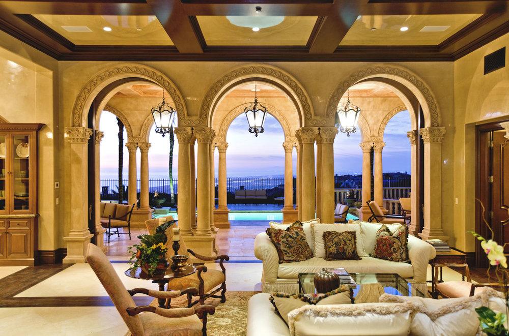 Traditional-Italianate-Living-Room-Rear-Yard-Views-Columns-Corbin-Reeves.jpg