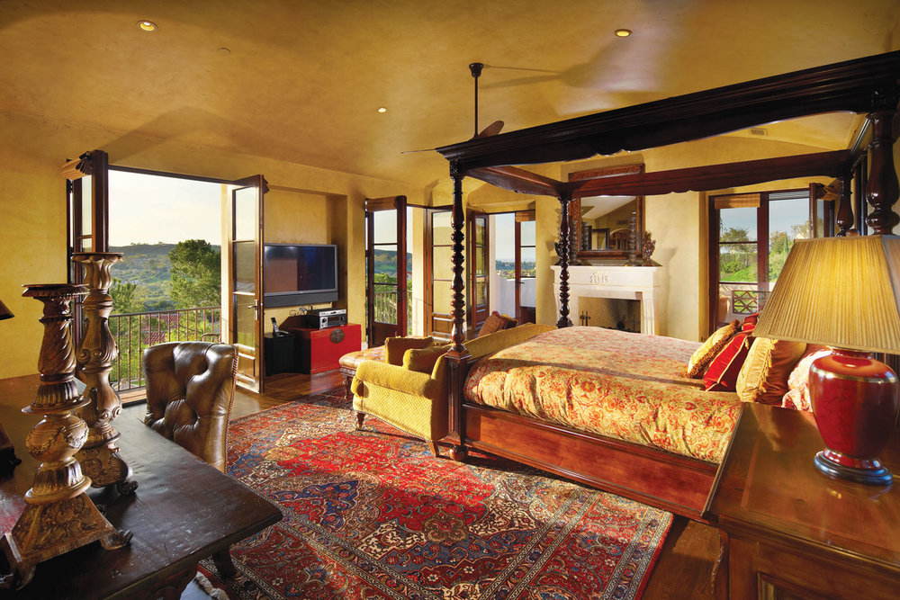 Contemporary-Spanish-Master-Bedroom-Barrel-Ceiling-French-Doors-Fireplace-Corbin-Reeves.jpg