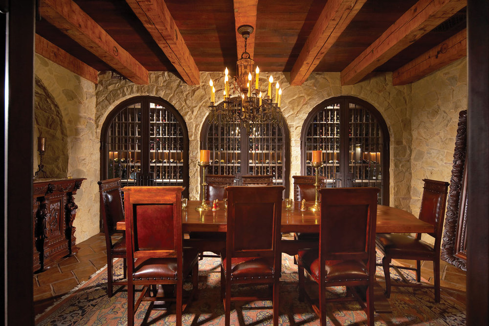 Spanish-Revival-Dining-Room-Stone-Walls-Beamed-Ceiling-Wine-Cellar-Corbin-Reeves.jpg