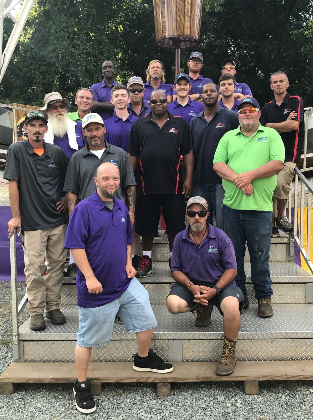 The hard working crew that makes sure the Matthews Alive carnival rides are safe and fun