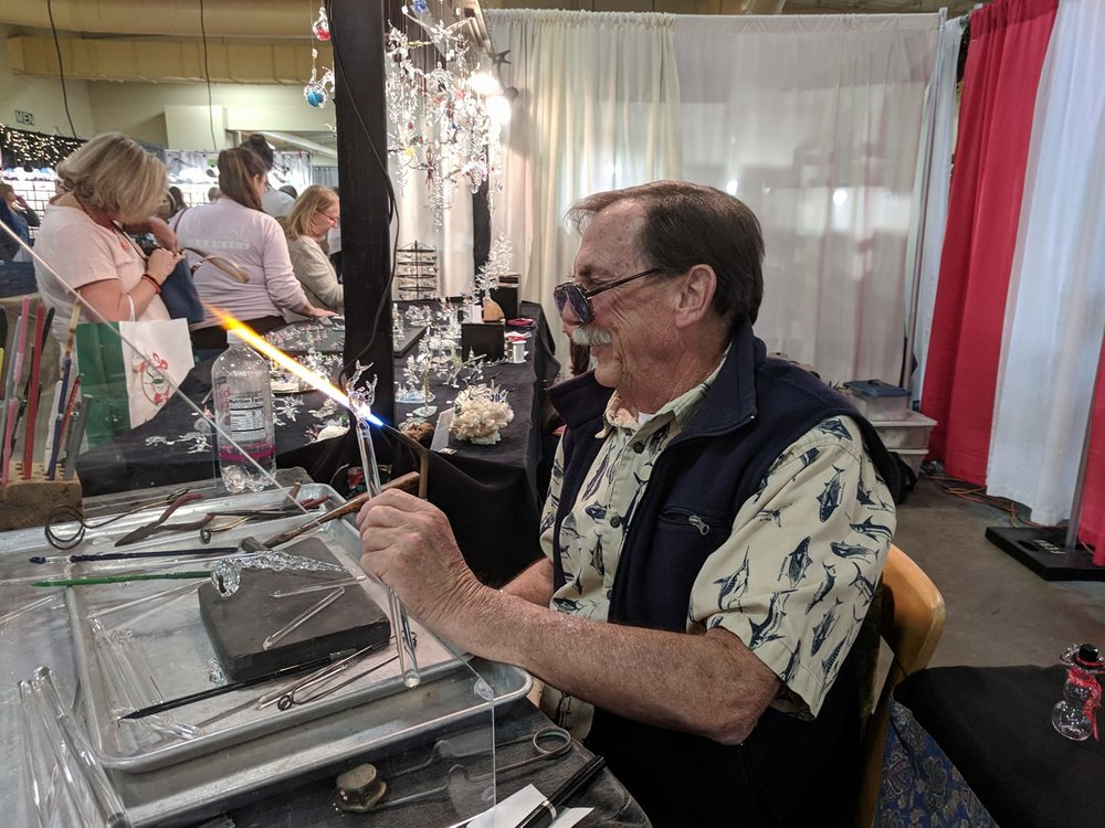 Every October artists and crafters from all over the US kick off their holiday sales season by setting up booths for three days in Cabarrus Arena. Over the long weekend, they'll see about 15,000 shoppers. -
