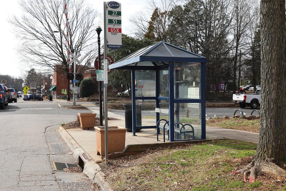 Bus stop on Trade Street in downtown Matthews.