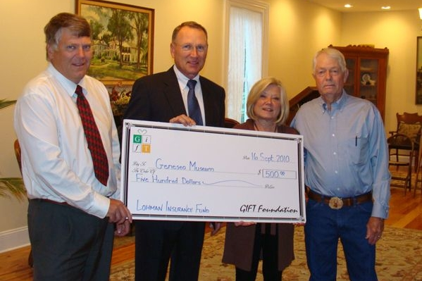 Les Stees, right, of Geneseo was presented with the 2010 GIFT Community Caring Award. In addition to the award, a $500 donation was made in Les' name to the Geneseo Historical Museum by Lohman Companies Insurance Foundation fund with GIFT. Pictured with Les are, from left: Brett Lohman of Lohman Companies Insurance; Bob Kuhns, president of the GIFT Foundation; and museum curator Angie Snook.