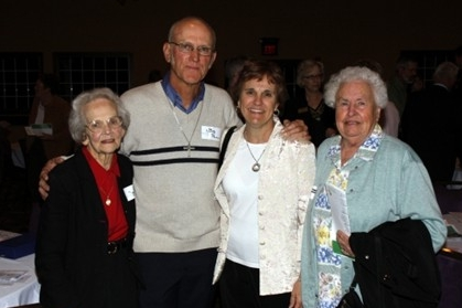 Pictured in the photo from left to right are: Hazel Pettit (Bob's mother), Bob Pettit, Ginny Pettit (Bob's wife) and Maxine Marchese (Bob's mother-in-law), all of whom he said are the team that he shares this award with.