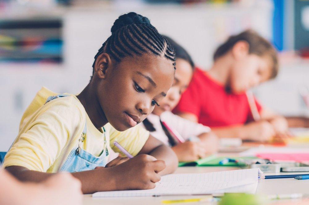 school-girl-writing-in-class-PUJVZAX (Priime Amplify)-1.jpg