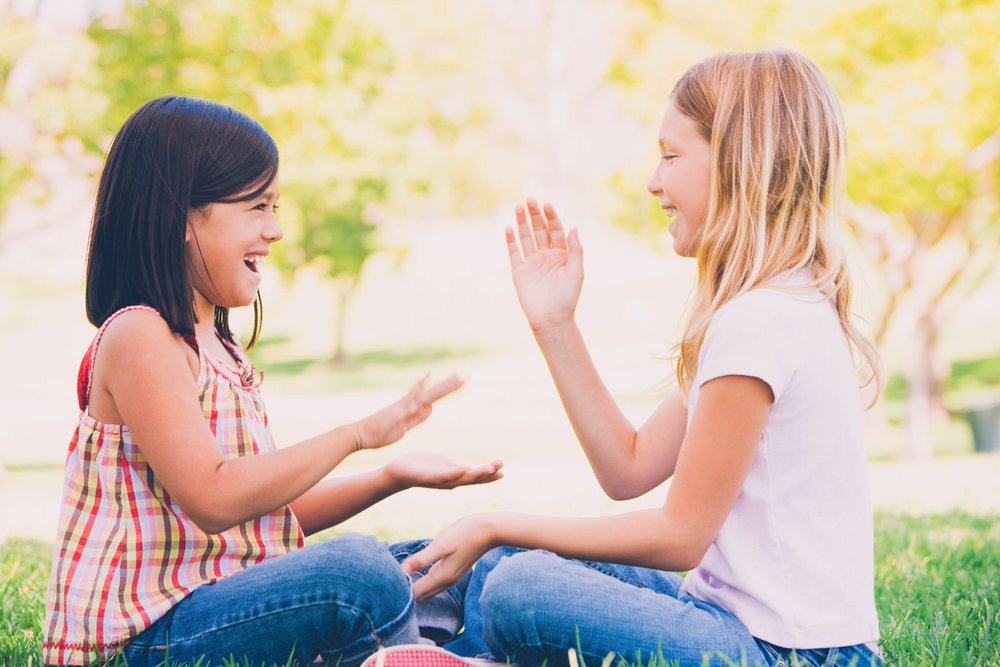 two-young-girl-friends-sitting-outdoors-playing-PS3CMU7 (Priime Amplify)-1.jpg