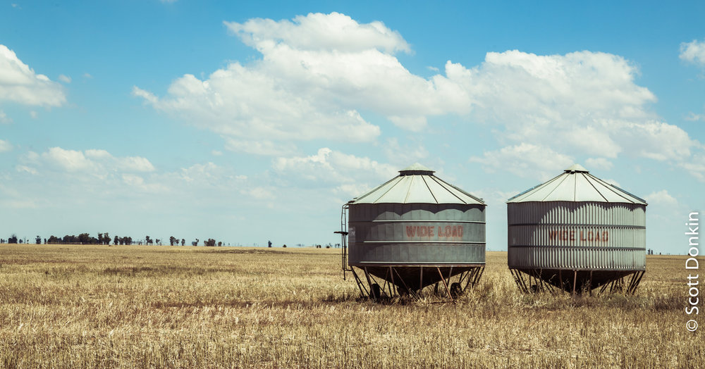 Seed trailers on dry farmland. Country Victoria.