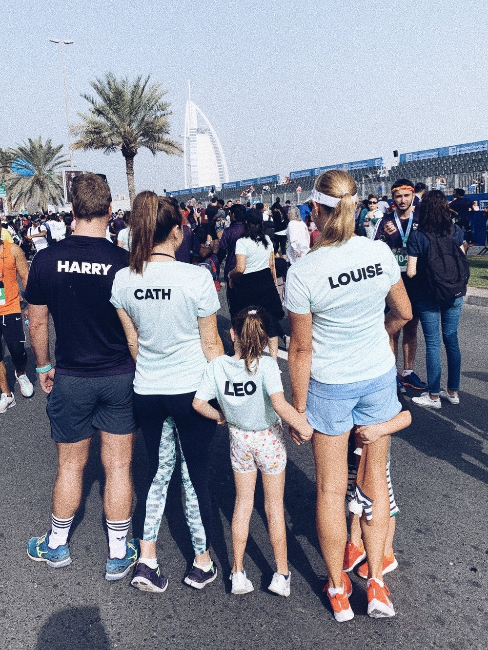 Uncle Harry, Aunty Cath, Leo and me in matching Adidas race shirts at the start line of the Dubai Standard Chartered Marathon 2019