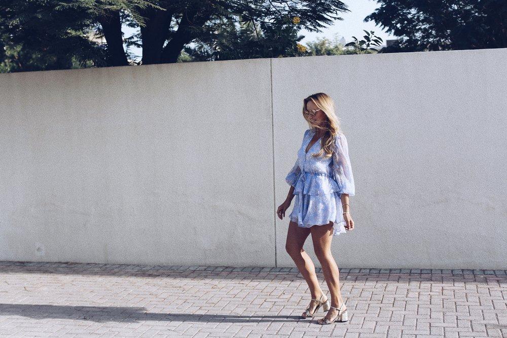 Dress  by Shona Joy   Sunglasses by Tiffany & Co   Shoes by Gucci