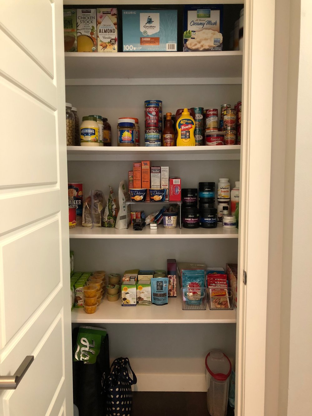 AFTER - An organized pantry makes it easier to see what you all have.  This prevents you from buying doubles!