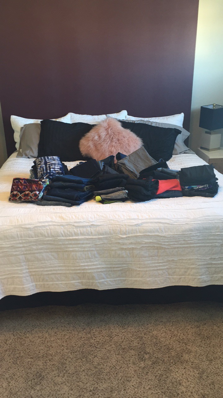 """DURING - We took everything out of her closet in sections. These are all of my client's yoga pants. My client picked up each piece of clothing and asked herself """"Does this item spark joy""""? If it did, she kept it. If it did not, we put it in a pile for donations."""