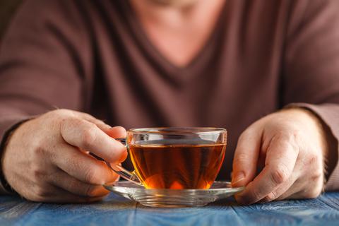 dreamstime_xs_100130244 © Andrey Cherkasov man drinking cup of tea.jpg