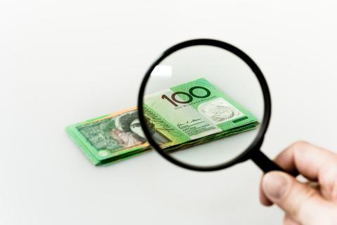 dreamstime_xs_37804966 © Island26 examining money magnifying glass.jpg