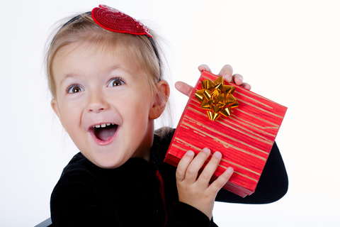 dreamstime_xs_79313114 © Ababaka child getting christmas gift.jpg